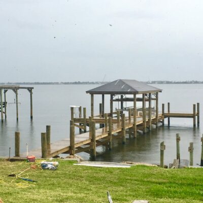Custom Boat Dock with Boat Lift and Roof