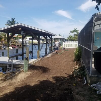 Custom Boat House with boat lift and shingle roof